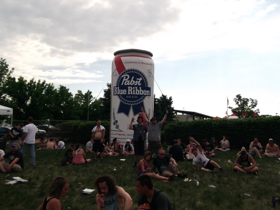couldn't pass up a giant PBR can. notice the photo-bombing, waving guy, and the shirtless, confused guy..